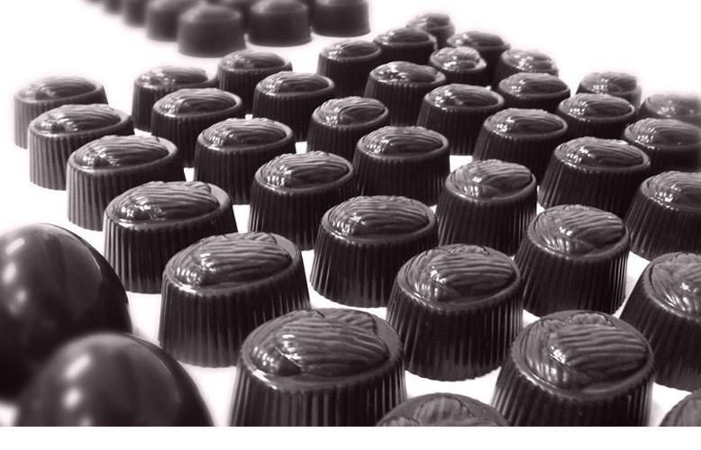 Chocolate truffles left to set on trays