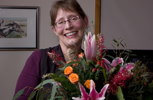 Kathy Malone - winemaker at Hillside Winery and winner of flowers from Art Knapp's Plantland and Flower Shop in Penticton
