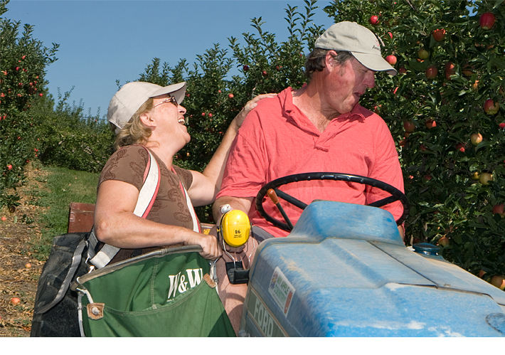 Richard and Denise MacDonald sharing a laugh in their orchard
