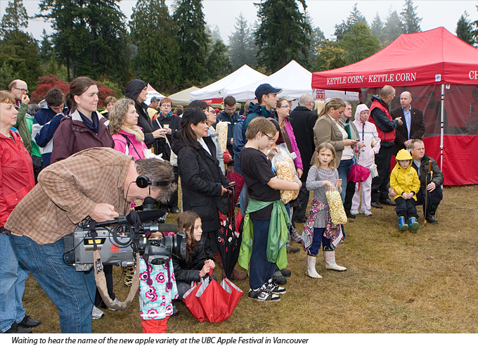 Ardent apple fans braving the rain and waiting for Salish name to be announced at UBC Apple Festival